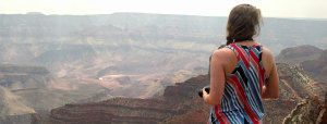 "Carrie ""Mudfoot"" Stambaugh peering out over the South Rim of the Grand Canyon. (Photo by Carl Stambaugh)."