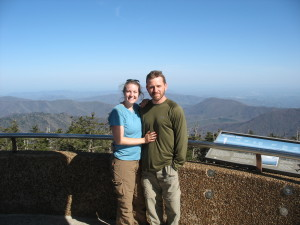 "Carrie ""Mudfoot"" Stambaugh and her husband, Carl ""The Fireman"" at the top of Clingman's Dome in the Great Smoky Mountains National Park. Behind them, the Appalachian Mountains roll away to the northern horizon."