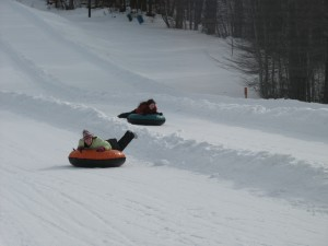 Snow tubing has become a popular winter sport in the Canaan Valley. The Canaan Valley Resort State Park recently renovated its tubing park to include 1,200 foot runs and a new lift. (Carrie Stambaugh)